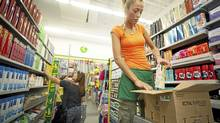 A Dollarama employee restocks shelves at the Dollarama store in Vaughan, Ont. (JENNIFER ROBERTS For The Globe and Mail)