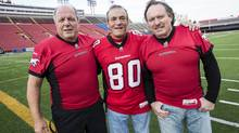 The Forzani brothers, from left, John, Tom and Joe, pose for a photo on Friday, September 12, 2012 at McMahon Stadium. (Chris Bolin For The Globe and Mail)