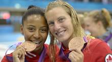 Canadian bronze medalists Jennifer Abel, left, and Emilie Heymans pose with their medals after the 3 Meter Synchronized Springboard final at the Aquatics Centre in the Olympic Park during the 2012 Summer Olympics in London, Sunday, July 29, 2012. (Associated Press)