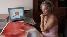 Barbara McClatchie Andrews, seen while working on art, was found dead on Friday near Merida, Mexico where she lived in a tight-knit Canadian ex-pat community. (Art Works Gallery/THE CANADIAN PRESS)