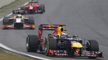 Red Bull Formula One driver Sebastian Vettel of Germany drives during the Brazilian F1 Grand Prix at Interlagos circuit in Sao Paulo November 25, 2012. (SERGIO MORAES/REUTERS)