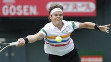 Milos Raonic of Canada returns the ball against Radek Stepanek of Czech Republic during their first round match of the Japan Open tennis championships in Tokyo, Tuesday, Oct. 2, 2012. (Koji Sasahara/AP)