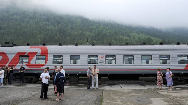 The Baikal-Amur Mainline railroad, en route to Moscow from Tynda, stops in Khani, Russia, July 4, 2012.