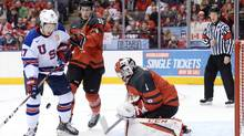 United States forward Jeremy Bracco (17) corrals a loose puck before scoring against Canada goaltender Connor Ingram (1) as forward Pierre-Luc Dubois (18) defends during second period IIHF World Junior Championship hockey action in Toronto on Saturday, Dec. 31, 2016. (Nathan Denette/THE CANADIAN PRESS)