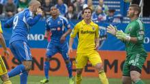 Montreal Impact Marco Di Vaio heads the ball over Columbus Crew goaly Matt Lampson to score during first half Major League Soccer action in Montreal on Saturday, September 14, 2013 (Peter Mccabe/THE CANADIAN PRESS)
