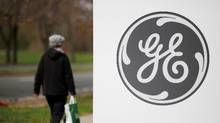 A pedestrian walks past a General Electric (GE) facility in Medford, Mass., April 20, 2017. (BRIAN SNYDER/REUTERS)