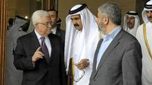 Palestinian President Mahmoud Abbas, Qatar's Emir Sheikh Hamad bin Khalifa al-Thani and Hamas leader Khaled Meshaal walk together in Doha, in this Feb. 6, 2012 handout picture released by the Palestinian Press Office. (Reuters/Reuters)