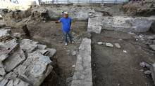 Archaeologist Keith Powers walks through the remains of John Small's house on King Street in Toronto. (Deborah Baic/The Globe and Mail)