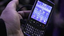 The new BlackBerry Torch is displayed during a product introduction, Tuesday, Aug. 3, 2010, in New York. (Richard Drew/AP)