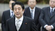 Japan's Prime Minister Shinzo Abe arrives at the controversial Yasukuni Shrine in Tokyo on Dec. 26, 2013 to pay tribute to the war dead. (Yuya Shino/Reuters)
