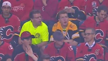 You Probably Saw These Neon Fans At The Flames Game Last Night. Here's Their Story (video)