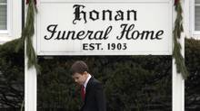 A boy walks is seen outside the funeral home where services for six-year-old Jack Pinto, one of 20 schoolchildren killed in the shootings at Sandy Hook Elementary School, were held in Newtown, Conn., Dec. 17, 2012. (Adrees Latif/REUTERS)