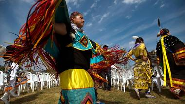 A member of the Assembly of First Nations dances at Fort York in Toronto last summer at the start of a memorial service commemorating first nations warriors who fought in the War of 1812.