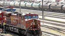 Canadian Pacific Railway locomotives are shuffled around a marshalling yard in Calgary. (Jeff McIntosh/ The Canadian Press)