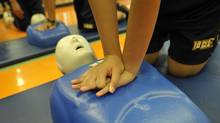 Students at Senator O'Connor College School practise CPR in Toronto, October 15 , 2010. (J.P. MOCZULSKI/J.P. MOCZULSKI for The Globe and Mail)