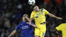 Leicester City midfielder Marc Albrighton, left, and Hector Herrara of Porto, right,compete for the ball in Champions League action Tuesday. Leicester City would go on to win 1-0. (ADRIAN DENNIS/AFP/Getty Images)