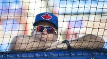 Toronto Blue Jays manager John Gibbons watches batting practice during baseball spring training in Dunedin, Fla., on Wednesday, Feb. 13, 2013. (Nathan Denette/THE CANADIAN PRESS)