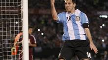 Argentina's Leonel Messi celebrates after he scored their second goal against Venezuela in a 2014 World Cup qualifying soccer match in Buenos Aires March 22, 2013. (ENRIQUE MARCARIAN/REUTERS)