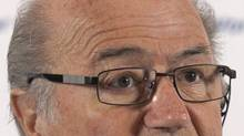 FIFA President Sepp Blatter speaks during a news conference in St. Petersburg on Sunday. (ALEXANDER DEMIANCHUK/REUTERS)