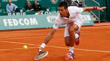 Serbia's Novak Djokovic plays a return to Italy's Andreas Seppi, during their match of the Monte Carlo Tennis Masters tournament in Monaco, Wednesday. (Claude Paris/Associated Press)