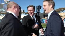 Anaheim coach Bruce Boudreau, left, Wayne Gretzky, centre, and Luc Robitaille (Nick Ut/AP)