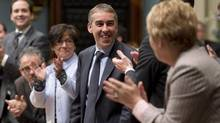 Quebec Finance Minister Nicolas Marceau, centre, is applauded by government colleagues after he voted for the adoption of his budget Friday, November 30, 2012 at the legislature in Quebec City. (Jacques Boissinot/THE CANADIAN PRESS)