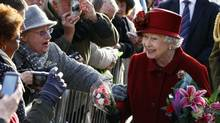 Britain's Queen Elizabeth, right, greets members of the public after visiting the Museum of Liverpool in Liverpool, England, Thursday, Dec. 1, 2011. (Tim Hales/AP/Tim Hales/AP)
