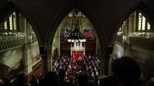 Attendees rise during the National Day of Honour ceremony in the Senate Chamber. (BLAIR GABLE/REUTERS)