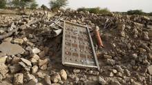 The rubble left from an ancient mausoleum destroyed by Islamist militants is seen in Timbuktu, Mali, in July, 2013. (JOE PENNEY/REUTERS)