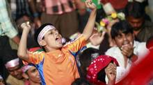A boy chants slogans during a mass demonstration demanding the execution of all war criminals, including Jamaat leader Abdul Kader Mullah, at Shahbagh intersection in Dhaka on Feb. 14, 2013. (ANDREW BIRAJ/REUTERS)