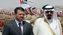 Saudi King Abdullah bin Abdul Aziz al-Saud (R) reviews the honour guard with Jordanian King Abdullah II (L) at Maraka airport in the Jordanian capital Amman, 28 June 2007. (Hassan Ammar/AFP/Getty Images/Hassan Ammar/AFP/Getty Images)