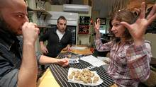 From left, Michael Sangregorio, managing owner of Local Kitchen and Wine Bar in Toronto, and chef/owner Fabio Bondi examine Wanda Srdoc's freshly delivered truffles from Croatia (Tim Fraser for The Globe and Mail/Tim Fraser for The Globe and Mail)