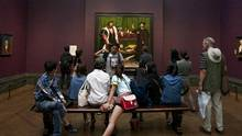 Visitors view Hans Holbein's The Ambassadors at the National Gallery in London. (Tom Dymond/London and Partners)