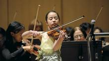 A student with the Royal Conservatory of Music performs with the Toronto Symphony Orchestra last year. (Kevin Van Paassen/The Globe and Mail)