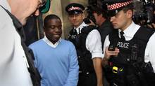 UBS equities trader Kweku Adoboli (C) leaves City of London Magistrates Court in central London, on September 16, 2011. (ADRIAN DENNIS/AFP/Getty Images/ADRIAN DENNIS/AFP/Getty Images)