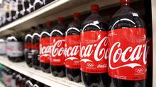 Bottles of Coca Cola are seen in a store display in New York in this February 9, 2010 file photo. (LUCAS JACKSON/REUTERS)