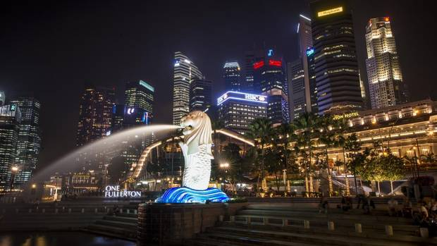 """Singapore's iconic Merlion statue features prominently on the original waterfront of Singapore. The mythical creature, with the head of a lion and the body of a fish, is used widely to promote the island state. The lion head represents Singapore's original name """"Singapura,"""" meaning lion city in Sanskrit, while its fish body represents its origins as a fishing village. (Edwin Koo for The Globe and Mail)"""