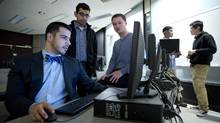 From left, Andrew Arruda, Akash Venkat, Pargles Dall'oglio, Jimoh Ovbiagele and Shuai Wang have been using Watson, IBM's supercomputer, to develop an artificially intelligent legal researcher called Ross. (Kevin Van Paassen For the Globe and Mail)