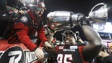 Ottawa RedBlacks' Moton Hopkins celebrates with fans after the RedBlacks defeated the Calgary Stampeders in the Canadian Football League's (CFL) 104th Grey Cup championship game in Toronto, Ontario, Canada November 27, 2016. (FRED THORNHILL/REUTERS)