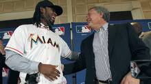 Miami Marlins owner Jeffrey Loria, right, and Jose Reyes share a laugh after a news conference at the Major League Baseball 2011 Winter Meetings in Dallas, Wednesday, Dec. 7, 2011. The Marlins unveiled the newly signed free-agent shortstop Reyes. (LM Otero/AP)