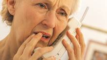 Worried woman on telephone (Comstock/Getty Images/Comstock Images)
