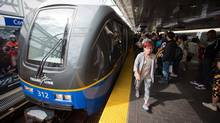 Passengers fill the platform as a SkyTrain arrives at Commercial-Broadway station during the afternoon rush in Vancouver on July 22, 2014. (DARRYL DYCK FOR THE GLOBE AND MAIL)