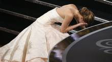 "Actress Jennifer Lawrence falls as she walks up the steps to accept the award for best actress for her role in ""Silver Linings Playbook"" at the 85th Academy Awards in Hollywood, California February 24, 2013. (Mario Anzuoni/Reuters)"