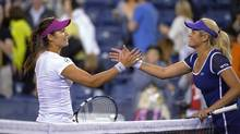 Li Na, left, of China, shakes hands with Aleksandra Wozniak, of Canada, after Li's 6-1, 6-4 win in a match at the BNP Paribas Open tennis tournament, Tuesday, March 11, 2014, in Indian Wells, Calif. (Mark J. Terrill/AP)