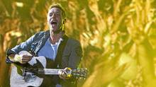 Coldplay's Chris Martin performs in Rio de Janeiro Sunday Oct. 2, 2011. (Felipe Dana/Felipe Dana / Associated Press)