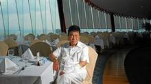 Yu Pengnian, China's biggest philanthropist, sits in the restaurant atop the hotel he built, where he lives and eats most of his meals. (Yang Junpo for The Globe and Mail)