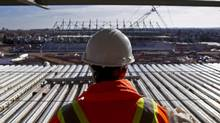 A construction worker overlooks the site of the CIBC Hamilton Pan Am Soccer Stadium in Hamilton on Nov. 14, 2013. (AARON LYNETT/THE CANADIAN PRESS)
