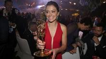 Tatiana Maslany holds her award after the 68th Primetime Emmy Awards in Los Angeles on Sept. 18. (LUCY NICHOLSON/REUTERS)