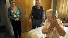 Katharina Lackner, 84, uses a special pole to help her get into and out of bed. Having taken a number of falls , her home is in the process of being evaluated to help prevent future falls. Nurse practitioner Anne Stephens and Katharina's husband Norbert, watch as she climbs into bed.( (Fred Lum/The Globe and Mail/Fred Lum/The Globe and Mail)