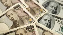 Japanese 10,000 yen notes (L) and U.S. $100 notes are seen in this picture illustration. (TRUTH LEEM/REUTERS)